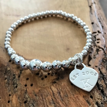 silver stretch bead bracelet with heart charm