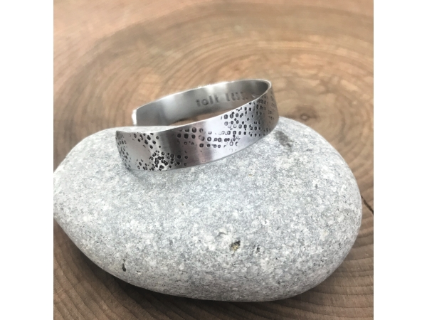 woman's custom message cuff